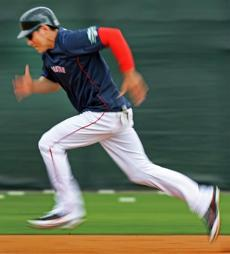 02-26-12: Fort Myers, FL: Red Sox CF Jacoby Ellsbury motors towards third base during a base running drill. (Globe Staff Photo/Jim Davis) section:sports topic:spring training